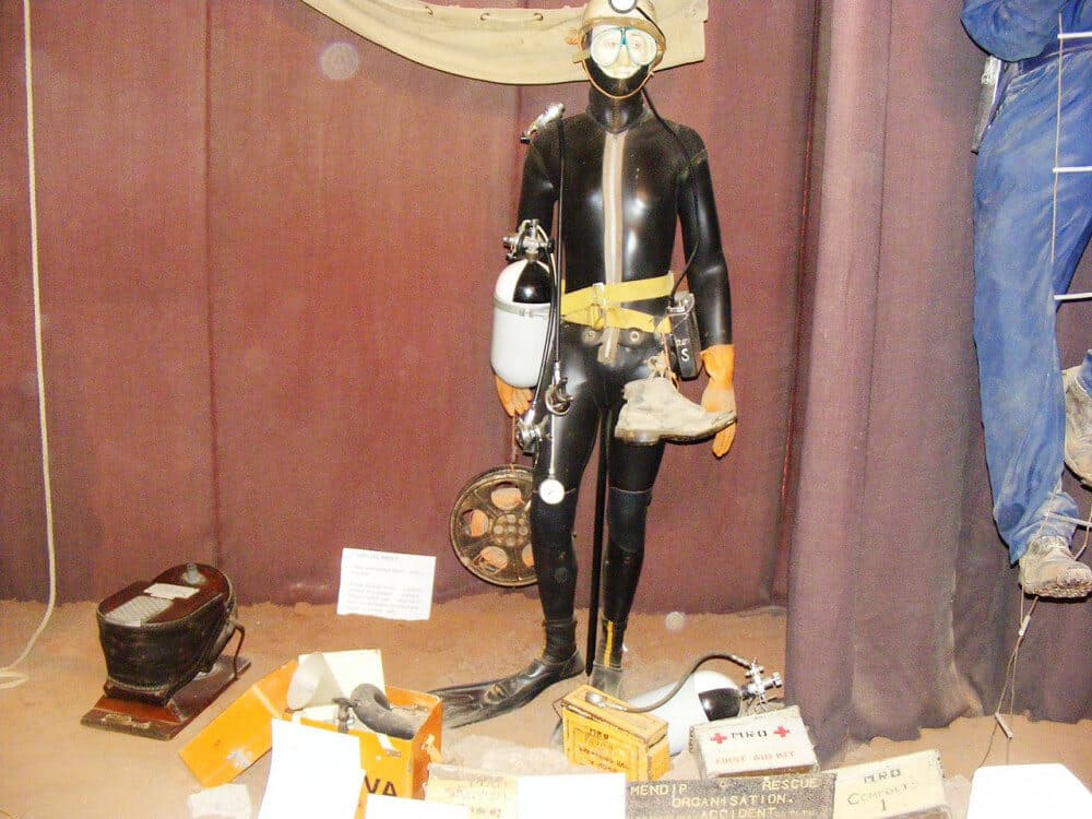 Photo of full cave diving gear: wet suit, goggles, helmet, gloves, and more
