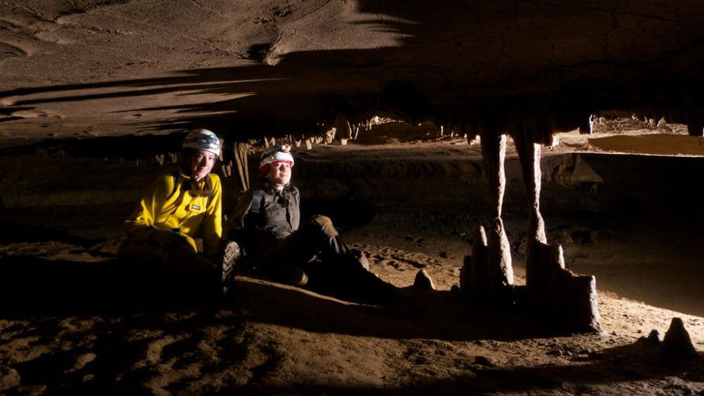 Picture of two geology students resting in a cave