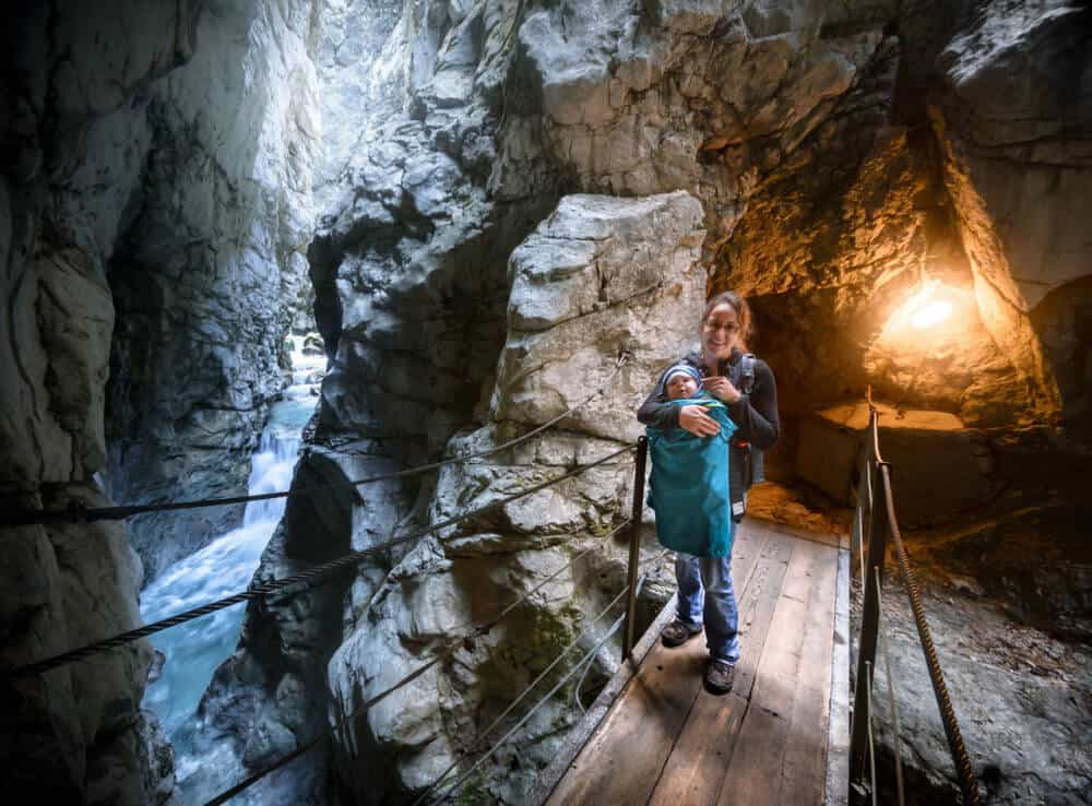 A woman and a child inside a show cave