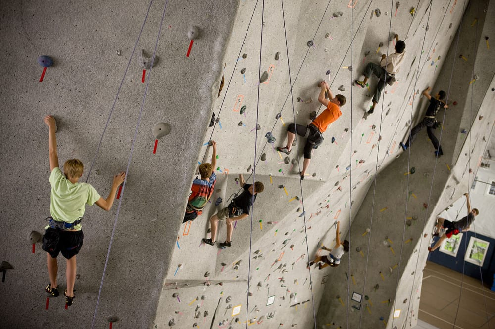 People on an indoor climbing wall