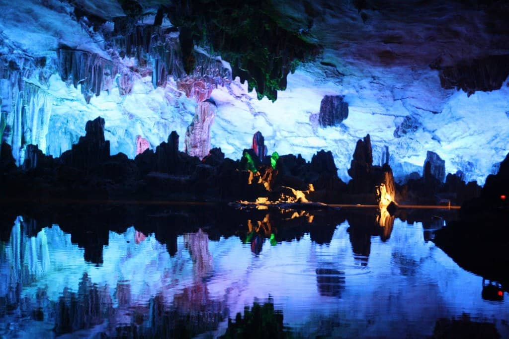 Blue and purple lighting in large cave
