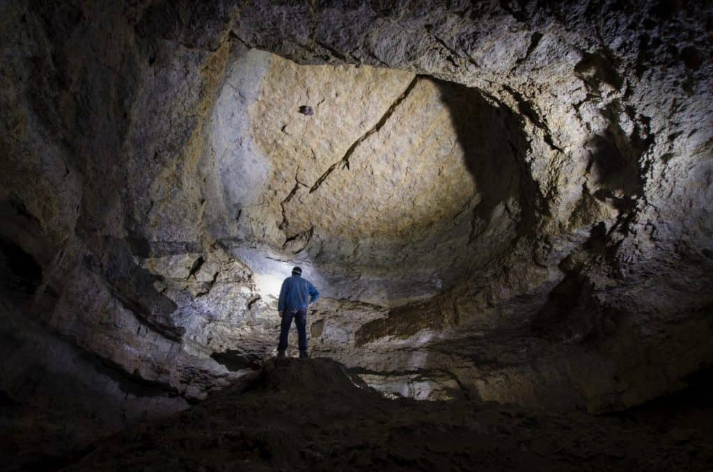 Man standing in a huge cave